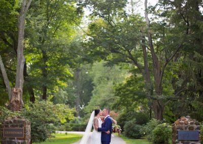 Bride and groom at the gate posts